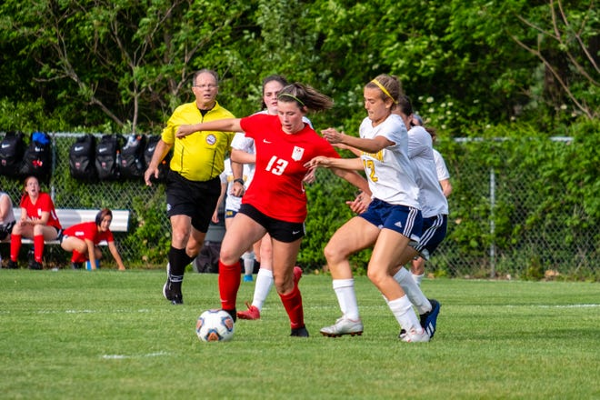 Port Huron's Kaylee Shattuck (13) and Northern's Addison Kiteley chase the ball during their game Tuesday, May 25, 2021, at Port Huron Northern High School.