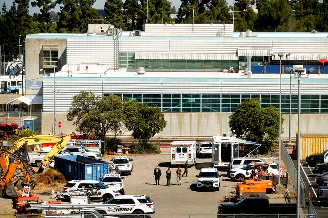 Law enforcement officers respond to the scene of a shooting at a Santa Clara Valley Transportation Authority (VTA) facility on Wednesday, May 26, 2021, in San Jose, Calif. Santa Clara County sheriff's spokesman said the rail yard shooting left multiple people, including the shooter, dead. (AP Photo/Noah Berger)