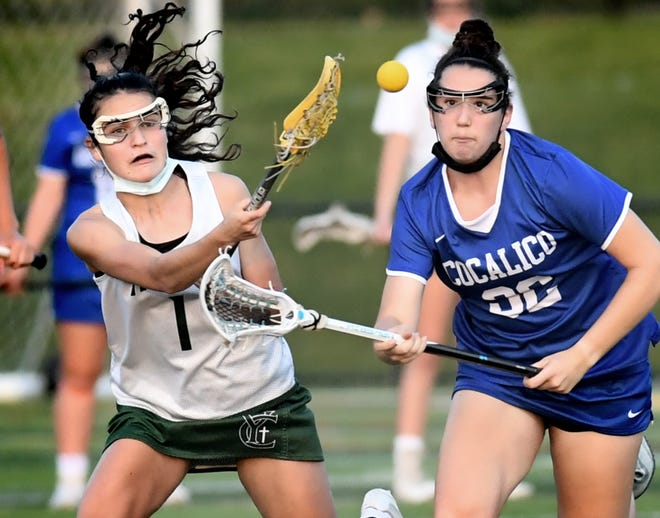 York Catholic's Olivia Staples, left, and Cocalico's Naleah Sauder chase a loose ball in a District 3 Class 2-A lacrosse semifinal at Catholic Tuesday, May 25, 2021. York Catholic took the win, 12-7. Bill Kalina photo