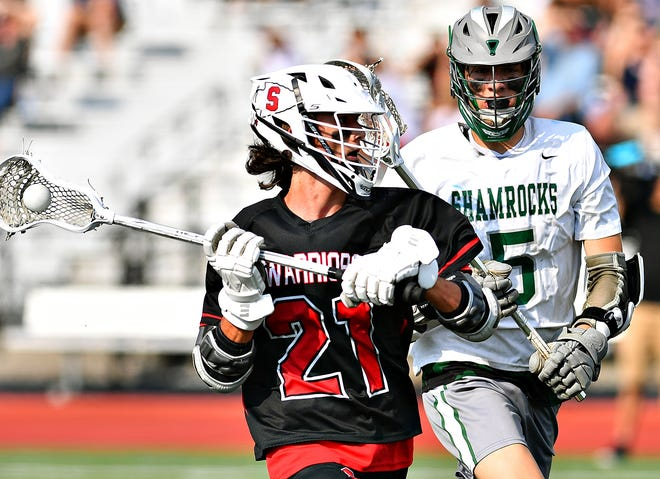 Susquehannock's Jake Wetzel, left, moves the ball down the field while Trinity's Paul Shook defends during PIAA District 3, Class 2-A boys' lacrosse championship action on Landis Field at Speed Ebersole Stadium at Central Dauphin Middle School in Harrisburg, Wednesday, May 26, 2021. Dawn J. Sagert photo