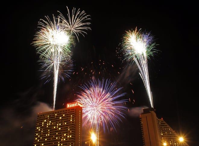 Fireworks explode over Victorian Square in Sparks during the Star Spangled Sparks celebration on Sunday, July 4, 2010.