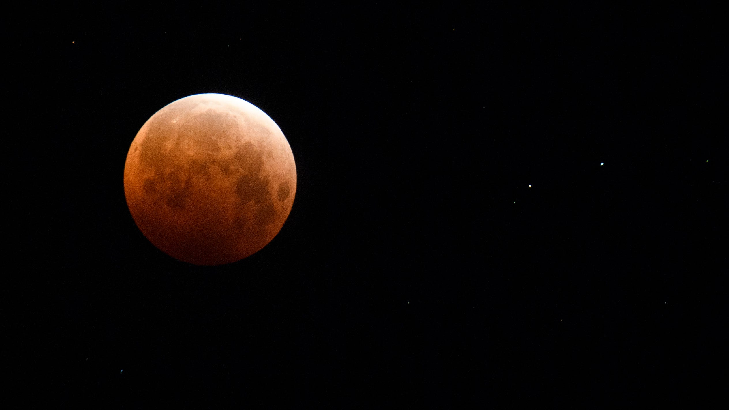 A full moon is seen during totality of a total lunar eclipse as the moon enters Earth's shadow for a