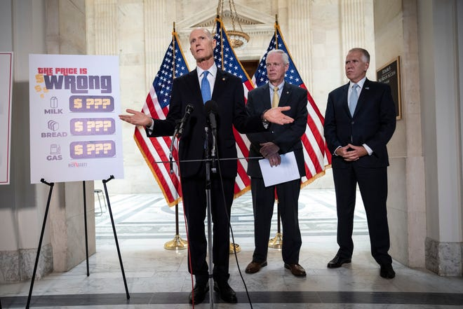 WASHINGTON, DC - MAY 26: (L-R) U.S. Sen. Rick Scott (R-FL), U.S. Sen. Ron Johnson (R-WI) and U.S. Sen. Thom Tillis (R-NC) hold a news conference about inflation on Capitol Hill on May 26, 2021 in Washington, DC. The group of Republican senators discussed rising consumer prices and the potential effects of inflation on families and businesses recovering from the pandemic.