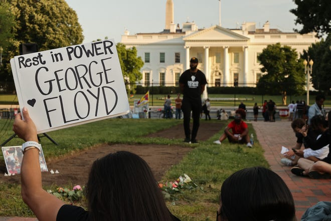 A small group of people gather for a vigil on the one-year anniversary of George Floyd's murder in Lafayette Square near the White House on May 25, 2021 in Washington, DC. Floyd's murder by Minneapolis police officer Derek Chauvin sparked global protest and continued to spur the Black Lives Matter movement.
