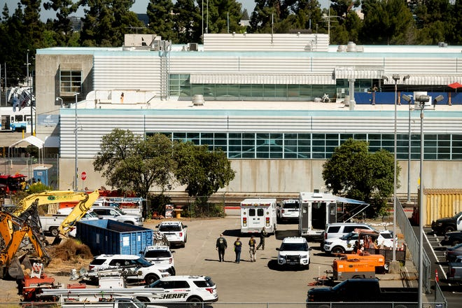 Law enforcement officers respond to the scene of a shooting at a Santa Clara Valley Transportation Authority (VTA) facility on Wednesday, May 26, 2021, in San Jose, Calif.