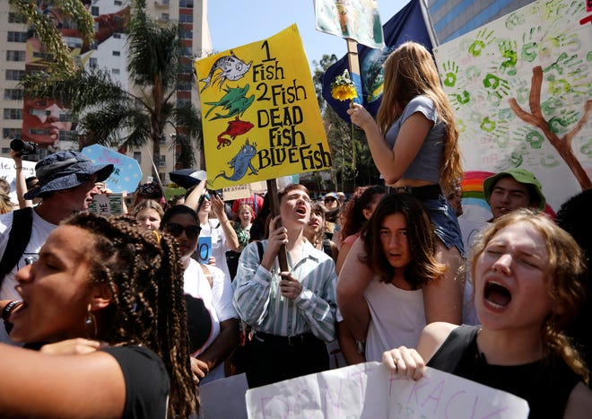 Protesters call on world leaders for action during a climate rally in downtown Los Angeles in 2019, part of a wave of demonstrations around the globe.