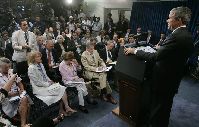 President George W. Bush takes a question from Ken Herman during an Aug. 21, 2006 press conference at the White House. Bush couldn't resist commenting on Herman's seersucker suit. [AP PHOTO/CHARLES DHARAPAK]