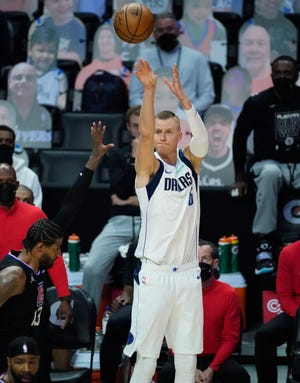 Dallas Mavericks center Kristaps Porzingis shoots a 3-pointer over LA Clippers guard Paul George during the Mavericks' win in Game 2 of the teams' opening playoff series Tuesday. The Mavericks are making half of their 3-point shots — 35-for-70 in two games.