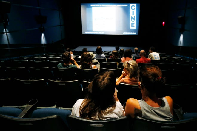 Patrons settle in to watch a movie at Ciné during the theaters reopening on Thursday, May 27, 2021. The theater was closed for more than a year due to the COVID-19 pandemic.