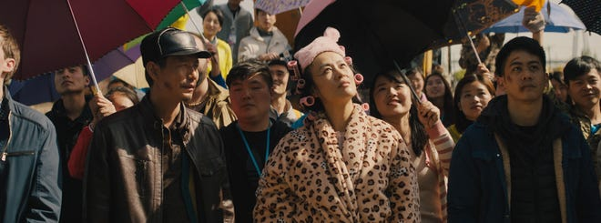 """Promotional still for """"Birds of Prey"""" director Cathy Yan's 2018 debut feature film, """"Dead Pigs,"""" available for streaming rental at Athens Ciné on May 28, 2021."""