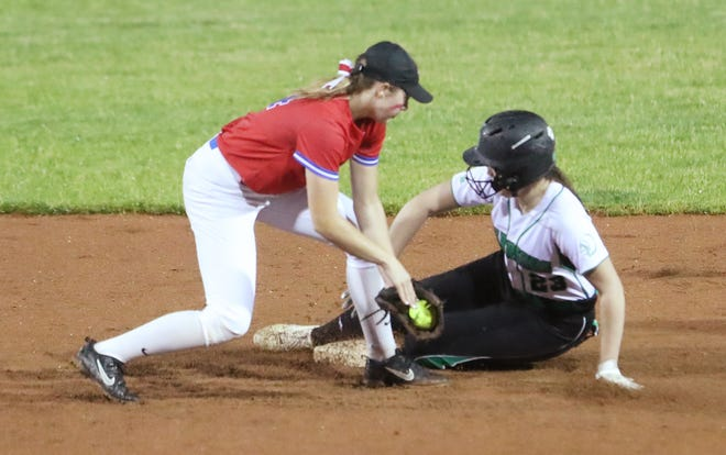 Revere's Jeanne Hujer tries to tag as West Branch's Mira Beckett safely steals second in the fifth inning of the Division II regional semifinal softball game at Firestone Stadium in Akron on Wednesday, May 26, 2021. West Branch beat Revere 12-2.