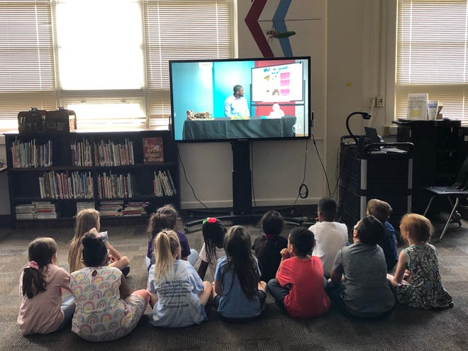 Wolflin Elementary students watch the premiere of season two of The Secret Classroom Wednesday. The first episode will re-air at 10:30 a.m. Saturday.