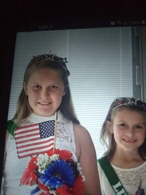 Eliana, left, and Emarie Johnson will represent Amvets Post 96 during Memorial Day by riding in the city parade and placing flowers at the memorial during the service at Ashland Cemetery. They are the children of Danny and Tara Johnson and the grandchildren of Mitch and Karen Johnson and Raymond Johnson.