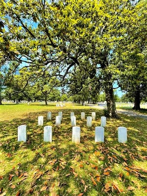 Markers in Augusta's Magnolia Cemetery memorialize a small contingent of Union soldiers who died here during the Civil War.