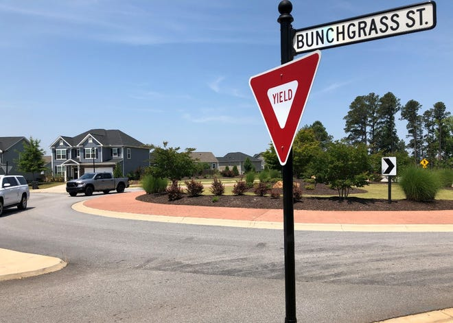 Trucks circle one of the roundabouts that help connect North Old Belair Road with William Smith Parkway through the Crawford Creek subdivision in Columbia County. Both roads might be included under the county's permit allowing police officers to operate radar.