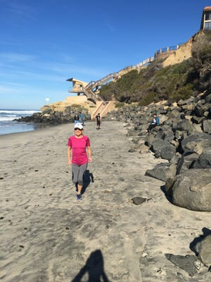Running along the ocean shoreline can provide relief from hot weather conditions.
