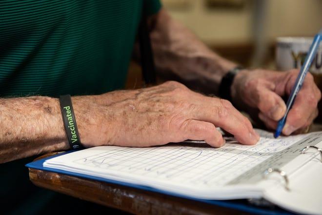 Visitors who are fully-vacinated are given a bracelet to wear while at Neshaminy Manor, giving them the privilege of removing their masks during their visit while in a vaccinated resident's room, in the all-purpose room or designated outdoor spaces. [MICHELE HADDON / PHOTOJOURNALIST]
