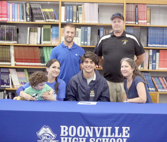 Boonville senior Evan Gonzalez recently inked a letter of intent to play Lacrosse at Columbia College in Columbia. Gonzalez held a signing ceremony last Wednesday in the media center at Boonville High School. Attending the ceremony were (front row, left to right) Jessica Coggins, Zeke Gonzalez, Evan Gonzalez and Vickie Boese. (back row, left to right) Hickman Lacrosse coach Brandon Huck, assistant coach Kenny Wright.
