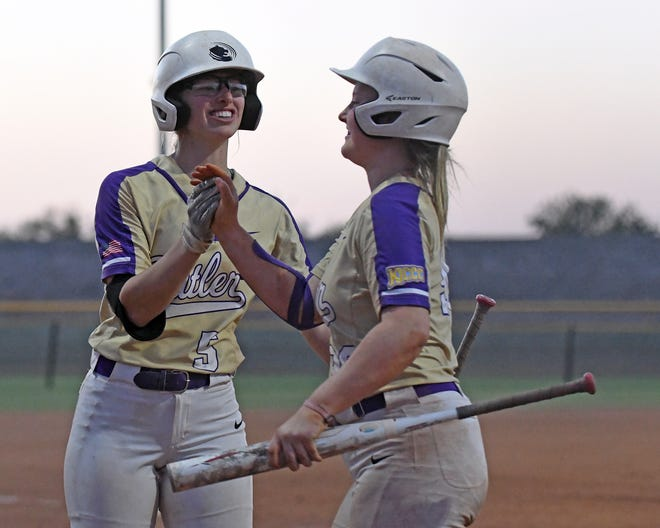 Butler's Shayna Espy (5) celebrates with teammate Myah Johnson during a four-run fifth inning in the Grizzlies' 12-4 victory over Three Rivers (Mo.) on Wednesday at the NJCAA National Tournament.