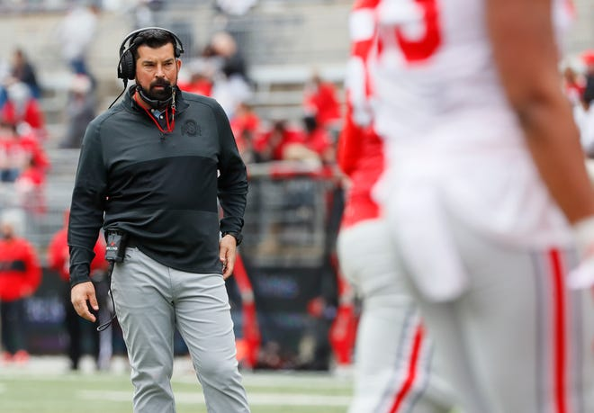 Ohio State Buckeyes head coach Ryan day watches from behind the line of scrimmage during the spring game at Ohio Stadium in Columbus on Saturday, April 17, 2021.