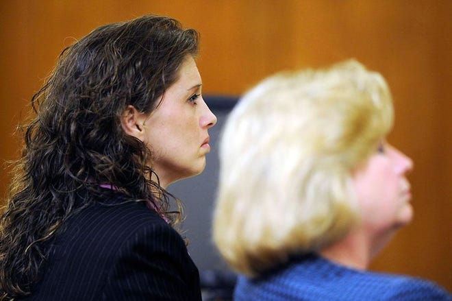Tausha Fields, left, listens to the Boone County Prosecutor's opening statement at her 2010 murder trial. Fields had sought relief from her life-sentence conviction, but was unable to prove her late filing was interfered with by her trial lawyer.