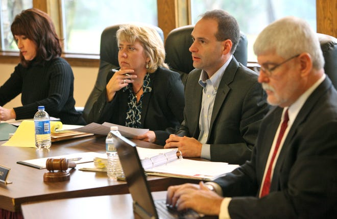 From left, elected officials Lisa Knapp, Debbie Taranto, Robert Quigley and outside attorney Michael McCarthy meet at the  Orange Township Community Park Board meeting uring a public comment period about an Orange Township fire levy on Dec. 7, 2012.