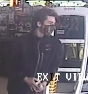 Columbus police and Crime Stoppers of Central Ohio say the man pictured here is suspected of robbing a Dollar General Store on Demorest Road on the Southwest Side on May 7.  Information leading to his arrest could result in a cash award.