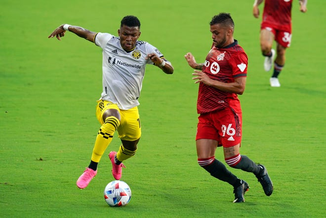 Crew midfielder Luis Diaz, here moving past Auro of Toronto FC earlier this month, is among the fastest players in Major League Soccer but needs to improve on his crossing passes to help produce goals.