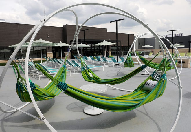 The rooftop deck of The City apartment complex on Olentangy River Road includes custom-made hammocks.