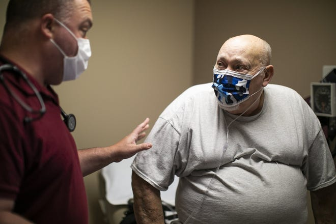 Dr. Joseph Winchell, sees his patient Ed Werner, 74, for one of his regular checkups, like he has done throughout the COVID-19 pandemic, in Pickerington. Unlike Werner, many men resist getting medical help, even when they are sick or in pain -- a problem that only got worse after the virus hit, but it's not too late for men to catch up, experts say.
