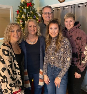 Leah Dufault, far right, with her sisters, Jaclyn and Alyson, and her parents, Debbie and Jeff
