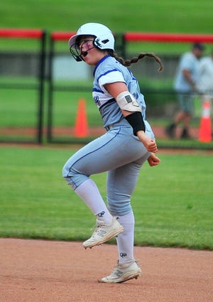 Triway's Hailey Massaro celebrates rounding first after slamming a homer in the first inning.