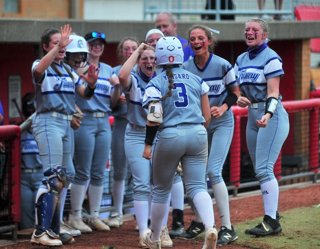 Hailey Massaro is greeted by her team after returning to the dugout after a 1st inning homer run.
