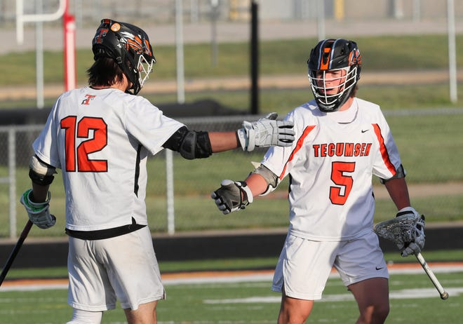 Tecumseh's Logan Moodt (12) celebrates with Cameron Kempainen (5) after scoring a goal in their Division 2 regional semifinal game against Temperance Bedford on Wednesday night.