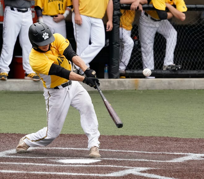 Adrian College's Ty Peck gets a hit during the MIAA championship series against Hope.