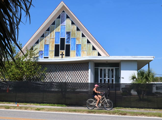 A bicyclist rides past the old Riverside Church on North Beach Street, Thursday May 27, 2021, Ormond Beach officials are moving foward with plans to convert the property into a parking structure.