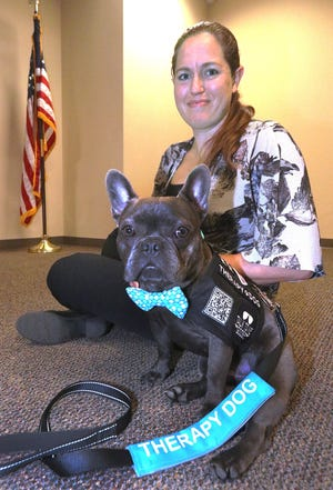 Flagler County Sheriff's office Detective Fiona Ebrill & therapy dog Goose, Wednesday May 26, 2021 in the Kim C. Hammond Justice Center.