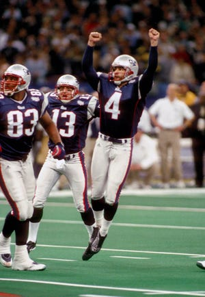 Feb 3, 2002; New Orleans, LA, USA; FILE PHOTO; New England Patriots kicker (4) ADAM VINATIERI celebrates after kicking a 48 yard field goal as time expired to win Super Bowl XXXVI against the St. Louis Rams at the Superdome 20-17.