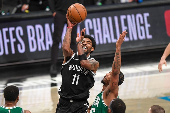 May 22, 2021; Brooklyn, New York, USA;  Brooklyn Nets guard Kyrie Irving (11) attempts a shot defended by Boston Celtics guard Marcus Smart (36) during the third quarter of game one in the first round of the 2021 NBA Playoffs. at Barclays Center.