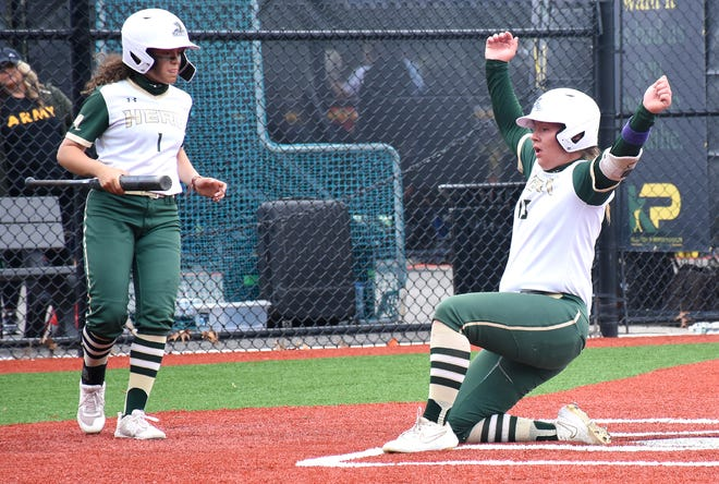 Herkimer College General Alexis Garrison celebrates after sliding safely across the plate with the first run against the College of DuPage in the opening round of the NJCAA's Division III national tournament Thursday at Carrier Park in Syracuse, New York.