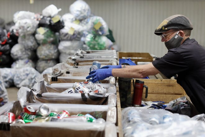 Russell Elliott, sorts cans at the Hope Haven Redemption Center Thursday June 4, 2020 in Burlington. Hope Haven is hiring for 30 positions. The organization added a $3 differential to its $12 per hour base wage at the start of the pandemic and is looking for ways to keep the differential in place.