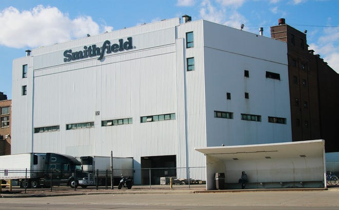 This April 8, 2020, file photo shows the Smithfield pork processing plant in Sioux Falls, S.D. The USDA said May 26 that it will not increase the speed at which pigs are processed into meat at U.S. pork plants rejecting a request from a group representing pork producers to allow processing plants to speed up the production of pigs into meat. A union representing workers claimed that the increased volume endangers workers.