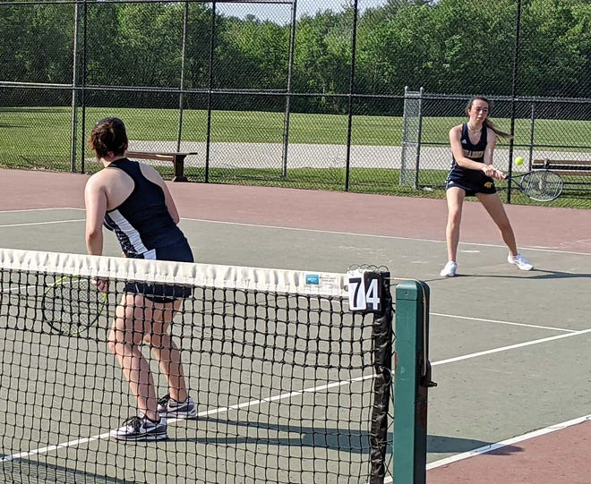 Quabbin's Kathleen Haddad makes a forehand return while her teammate Hannah Hebert looks on during a second doubles match against the Gardner Wildcats on Wednesday, May 26, 2021. The Panthers garnered the top overall seed in next week's Central Mass. Division 2 girls' tennis tournament.