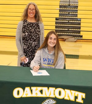 Oakmont senior Lilly O'Mara, pictured with her mother Julie at a recent signing ceremony in the Spartans' gym, will continue her education and her soccer career at Western New England University this fall.