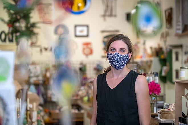 Hillary Anderson poses for a photo inside her shop, Dovetail Rivet & Stitch, located at 61 S. Seminary St., on Wednesday, May 26, 2021.