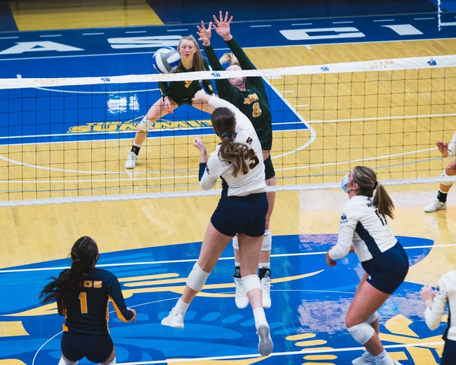 University of Missouri–Kansas City's Carly Gillen goes up for a kill in a match last fall.
