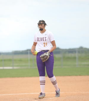 Olivet Nazarene's Emily Blucker, a 2020 Galesburg High School grad, preps to deliver a pitch in a game this season.