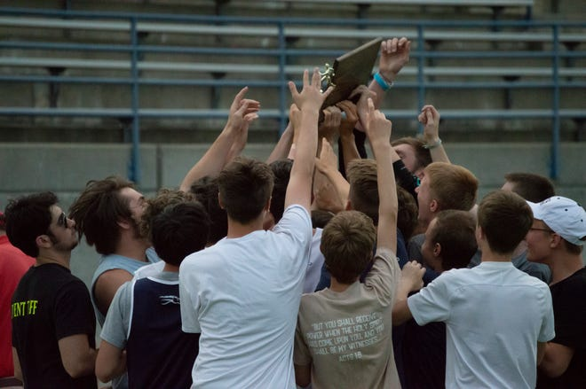 The Hillsdale Academy Boys track and field team celebrates their SCAA Championship