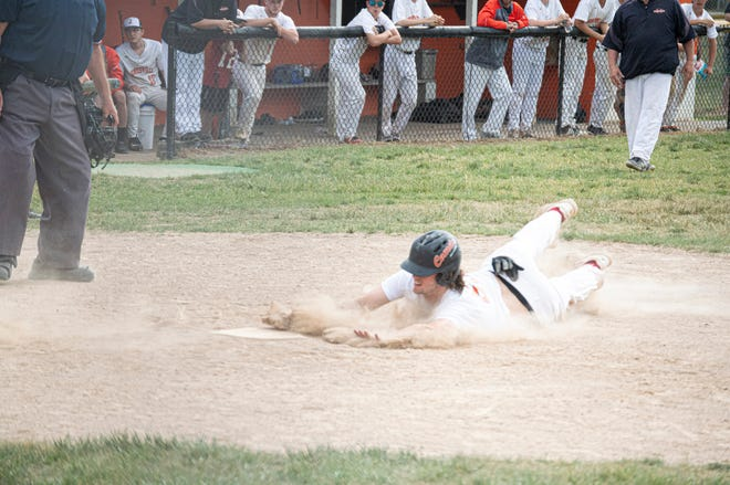 A Jonesville runner slides into home plate to help their team win the first game of a double header sweep over Concord.
