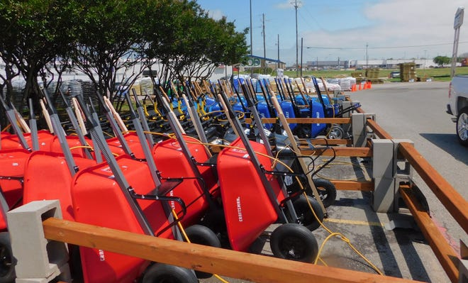 Rows of wheelbarrows stand lined up at Sherman's Lowe's Home Improvement. The Sherman City Council recently approved outdoor display permits for the business.